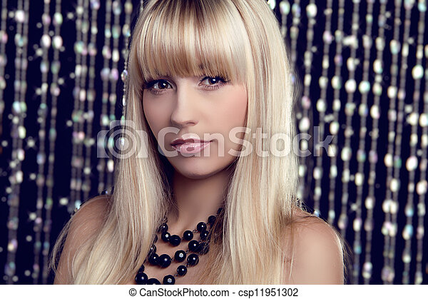 Glamour portrait of beautiful woman model with makeup and blond hairstyle. Fashion girl on holiday background