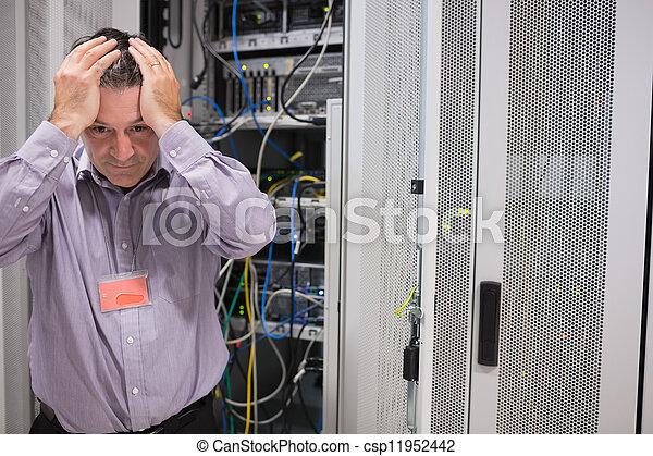 Man looking weary of data servers - csp11952442
