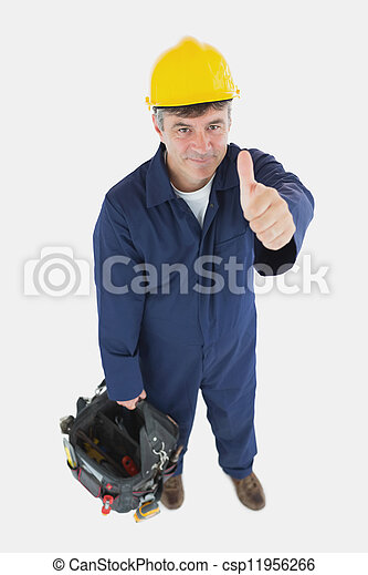 Technician with tool bag gesturing thumbs up - csp11956266