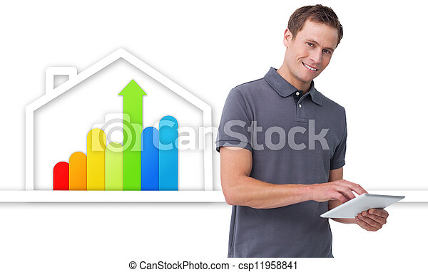 Man using tablet against energy efficient house graphic - csp11958841