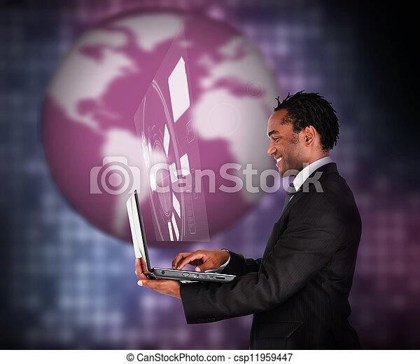 Smiling businessman using laptop - csp11959447