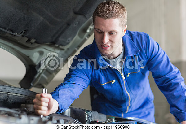 Mechanic working on automobile engine - csp11960908
