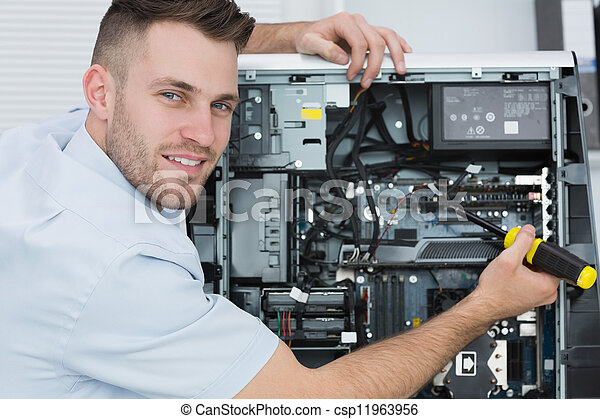 Portrait of computer engineer working on cpu - csp11963956