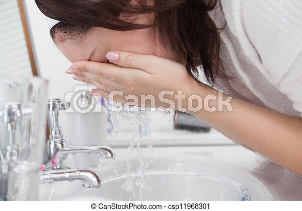 Close-up of woman washing face - csp11968301