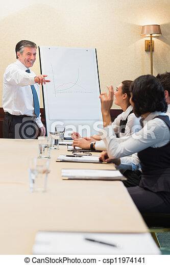 Smiling man pointing during presentation - csp11974141