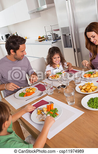 Family eating healthy dinner - csp11974989