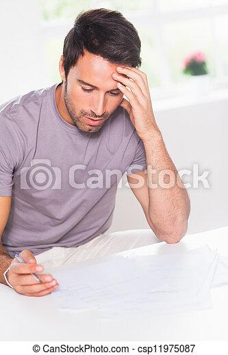 Man doing his accounting - csp11975087