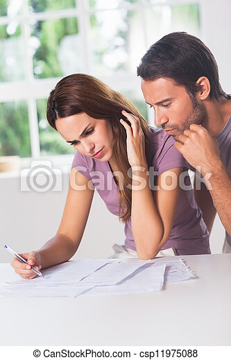 Couple doing their accounting - csp11975088