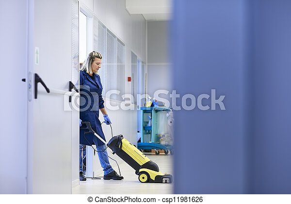 Woman working, professional maid cleaning and washing floor with machinery in industrial building. Full length, copy space - csp11981626