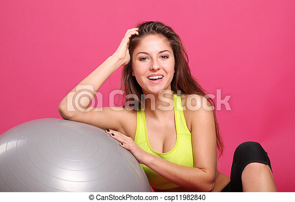 Happy and beautiful woman with fitness ball - csp11982840