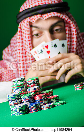 Arab playing in casino - gambling concept with man - csp11984254