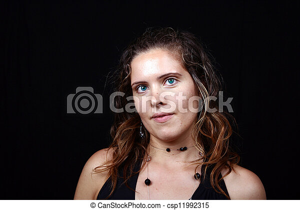 beautiful young woman posing in black background - csp11992315