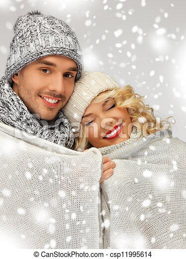 family couple under warm blanket