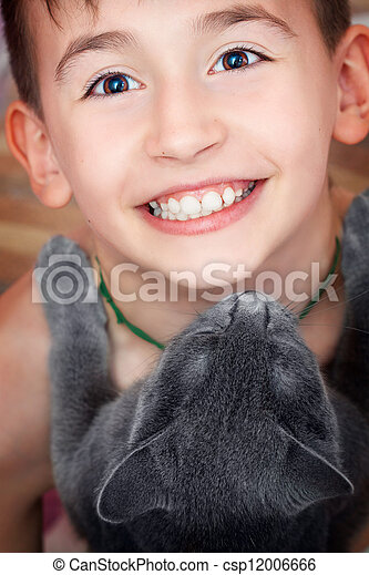 Happy boy with a cat