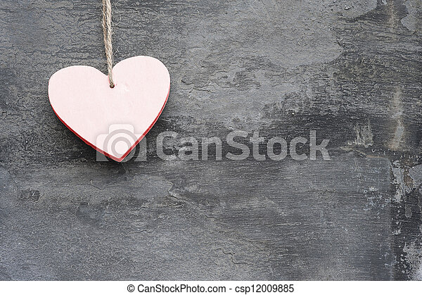 Valentine's Day love heart on rustic style background - csp12009885