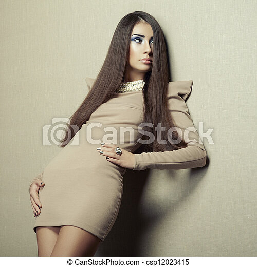 Fashion photo of young sensual woman in beige dress - csp12023415