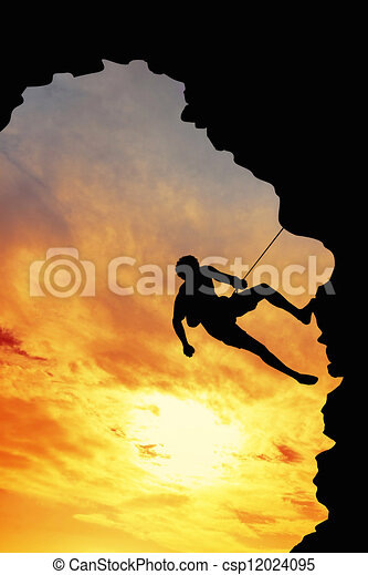 Climber at sunset - csp12024095