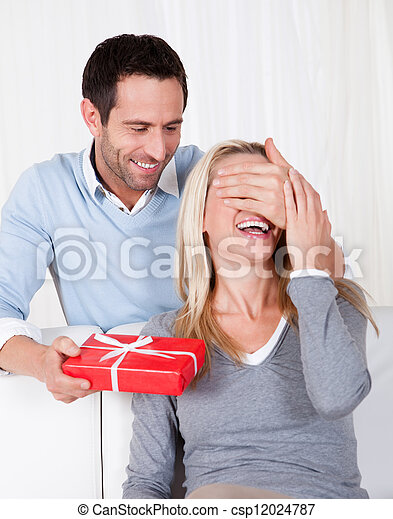 Man giving his wife a surprise gift - csp12024787