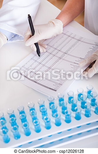 technicians at work in a laboratory - csp12026128
