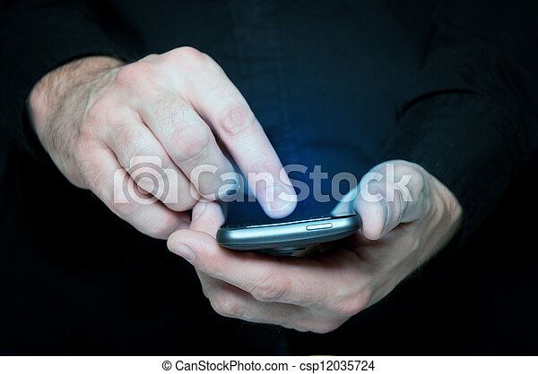Man typing a text message on a smartphone - csp12035724