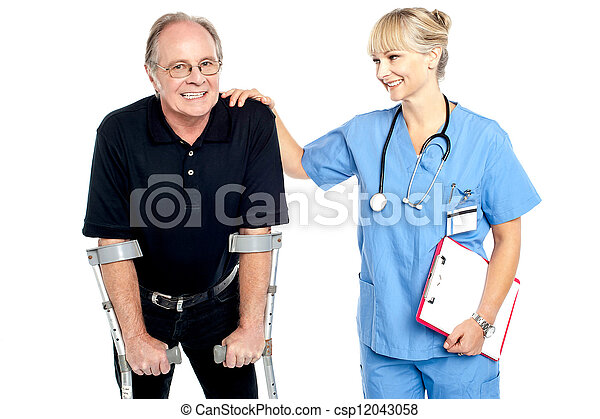 Cheerful doctor encouraging her patient to walk with crutches - csp12043058