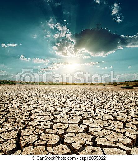 dramatic sunset over drought land - csp12055022