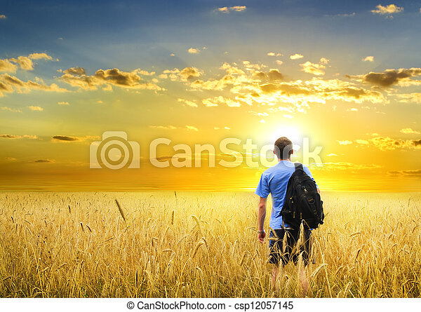 Man in yellow wheat meadow. - csp12057145