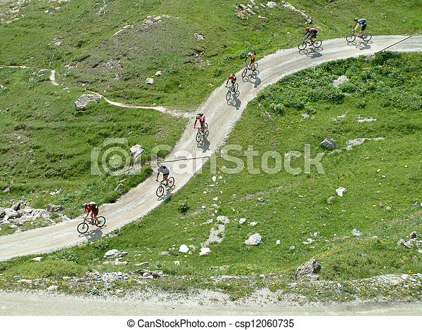 Mountain bikers crossing the mountains - csp12060735