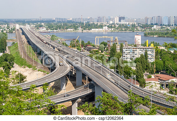 View of highway and railway bridges from a hill over the Dnieper river. Kyiv, Ukraine - csp12062364