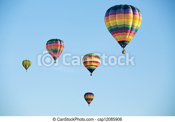Colorful hot air balloons on the blue sky - csp12085906