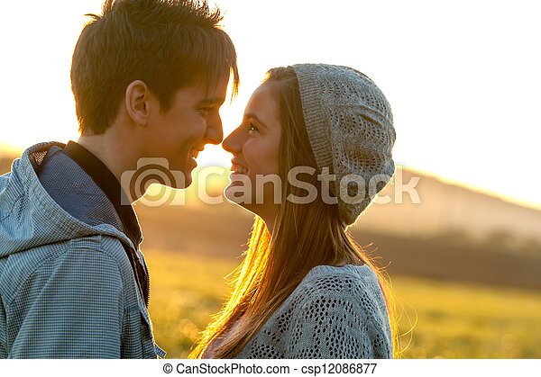 Romantic couple showing affection at sunset. - csp12086877