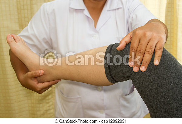 Doctor checking the knee joint - csp12092031