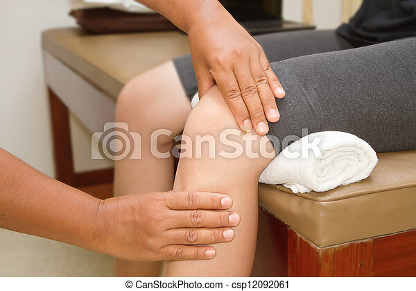 Doctor checking the knee joint - csp12092061