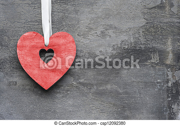 Valentine's Day love heart on rustic style background - csp12092380