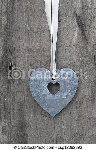 Valentine's Day love heart on rustic style background - csp12092393