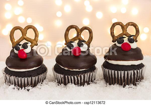 bilder von rentier cupcakes gruppe von drei rentier cupcakes csp12113672 suchen sie. Black Bedroom Furniture Sets. Home Design Ideas