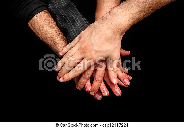 Group of young adults making a pile of hands - csp12117224