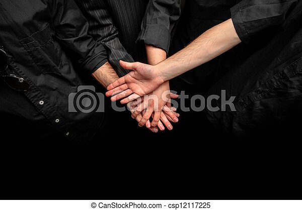 Group of young adults making a pile of hands - csp12117225