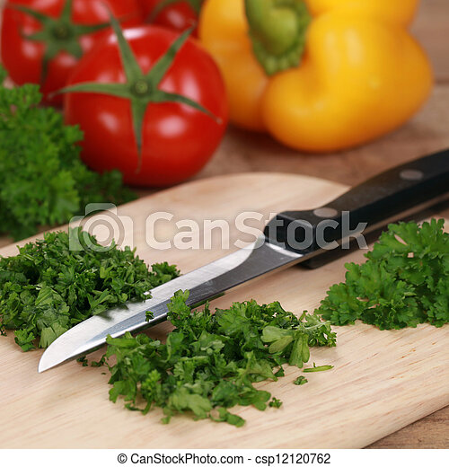 Preparing food: Chopping parsley - csp12120762