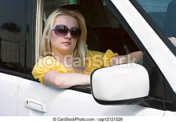 Woman and the automobile - csp12121526