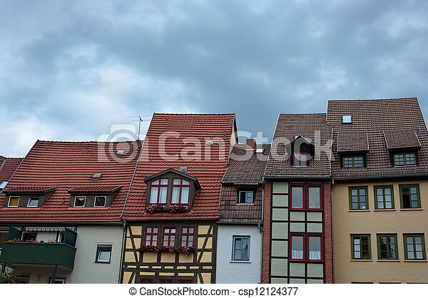 Residential apartment buildings with tiled roofs. - csp12124377