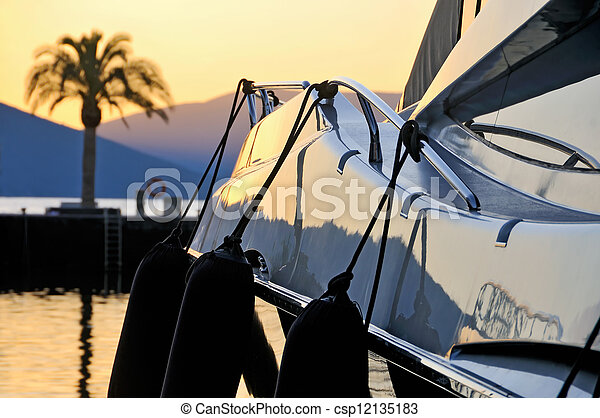 Sunset palm & yacht - csp12135183