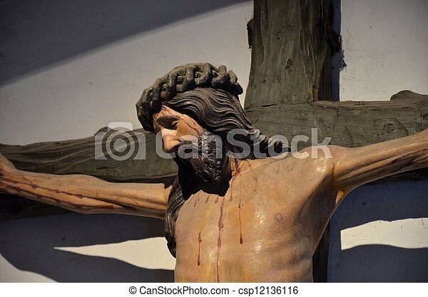 Christ crucified on cross - csp12136116