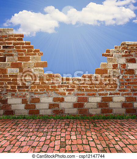 old brick wall and blue sky with sun light for design - csp12147744