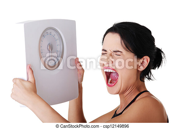 Frustrated woman with scale - csp12149896