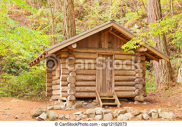 Old solid log cabin shelter hidden in the forest - csp12152073