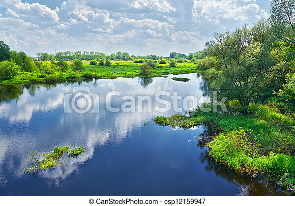 Spring landscape with Narew river and clouds on the sky - csp12159947