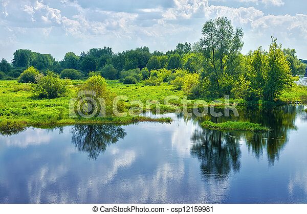 Spring landscape with river and clouds on the sky - csp12159981