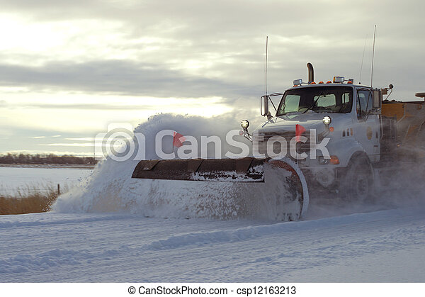 Snow plow after winter storm - csp12163213