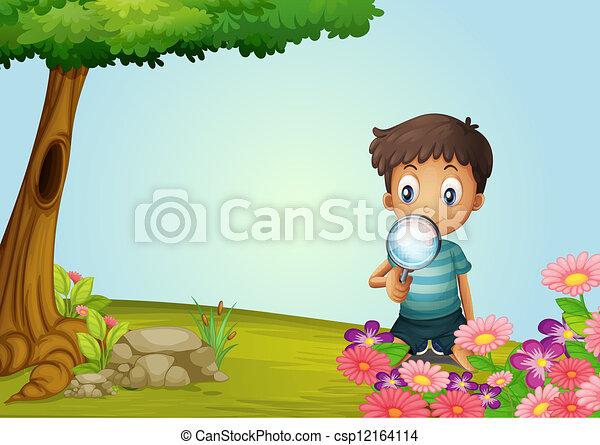 A boy with lense in garden - csp12164114